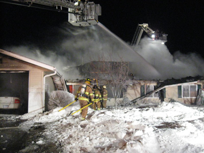 Exterior fire operations, Savage firefighter, Minnesota townhouse fire